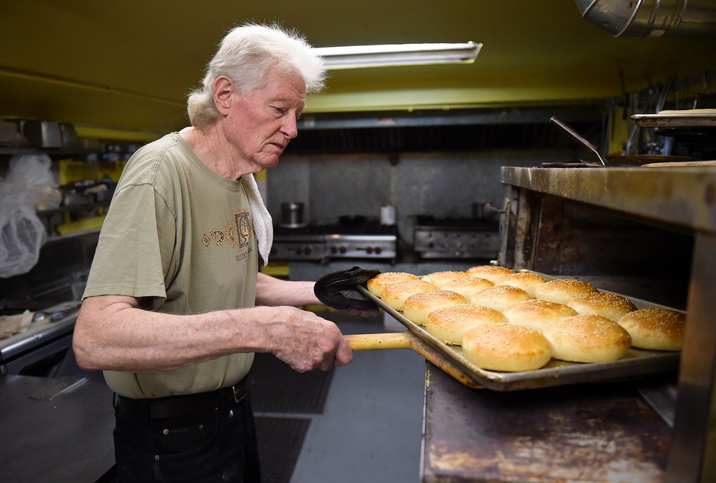 . WARD, CO - SEPTEMBER 13, 2018: Kirk Byers pulls his homemade hamburger buns out of the oven at the Millsite Inn in Ward Sept. 13. The historic restaurant, which opened in the mid-late 1930s, is closing at the end of this month. (Photo by Lewis Geyer/Staff Photographer)