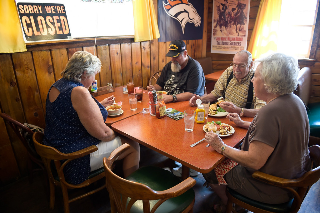 . WARD, CO - SEPTEMBER 13, 2018: From left: Susan Naugle, her husband David Naugle, his father Dave Naugle, and Daphne Clement have lunch at the Millsite Inn in Ward Sept. 13. The historic restaurant, which opened in the mid-late 1930s, is closing at the end of this month. (Photo by Lewis Geyer/Staff Photographer)