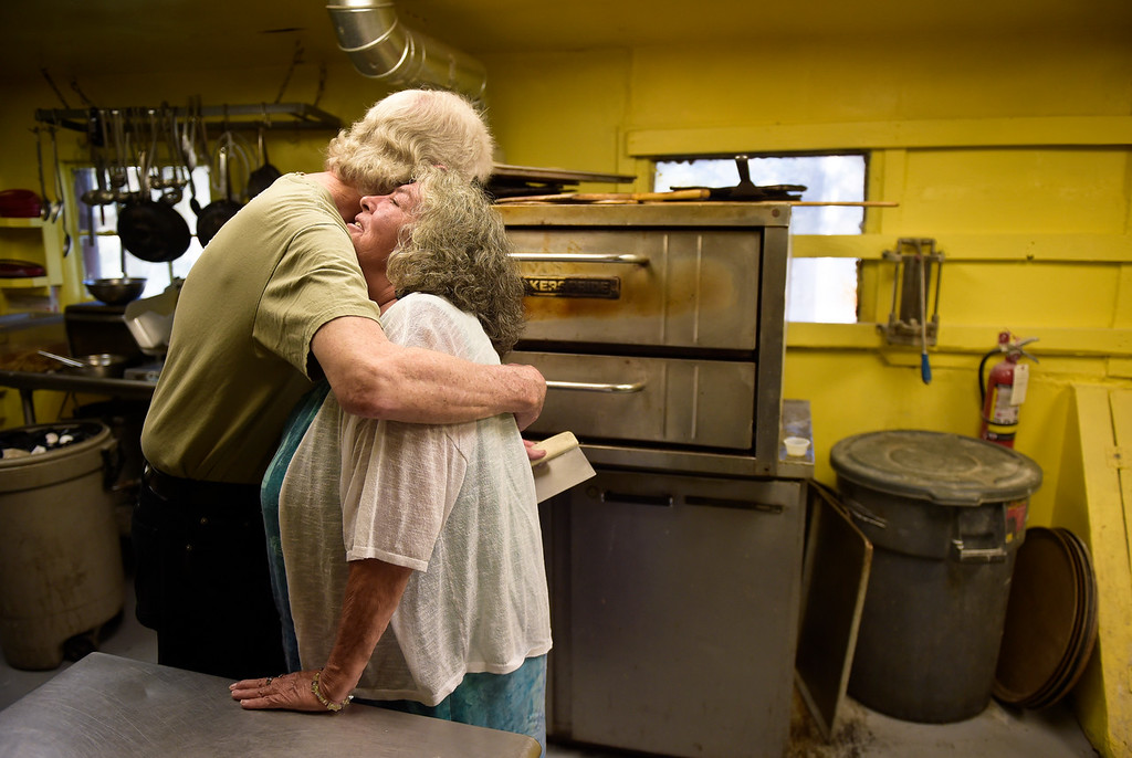 ". WARD, CO - SEPTEMBER 13, 2018: Kirk Byers hugs Pam Davis in the kitchen of the Millsite Inn in Ward Sept. 13. Davis used to earn $1 an hour plus tips when she worked at Millsite. ""These guys are my family up here,\"" she said. The historic restaurant, which opened in the mid-late 1930s, is closing at the end of this month. (Photo by Lewis Geyer/Staff Photographer)"