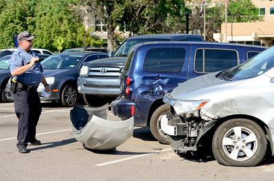 Photos: Minivan Hits 7 Parked Vehicles in Longmont Parking Lot