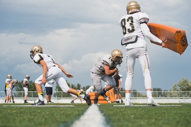 "Will Ponder (center) participates in a drill during football practice at Monarch High School on Friday.<br /> More photos:  <a href=""http://www.BoCoPreps.com"">http://www.BoCoPreps.com</a><br /> (Autumn Parry/Staff Photographer)<br /> August 19, 2016"