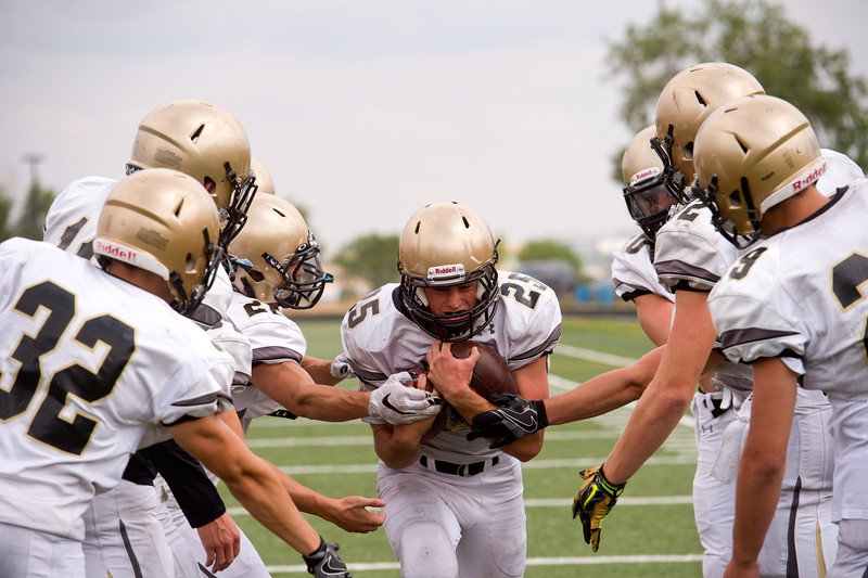 "Alex Bradfield (center) participates in a drill during football practice at Monarch High School on Friday.<br /> More photos:  <a href=""http://www.BoCoPreps.com"">http://www.BoCoPreps.com</a><br /> (Autumn Parry/Staff Photographer)<br /> August 19, 2016"