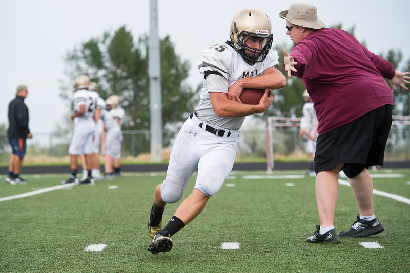 "Alex Bradfield carries the ball down the field as he  participates in a drill during football practice at Monarch High School on Friday.<br /> More photos:  <a href=""http://www.BoCoPreps.com"">http://www.BoCoPreps.com</a><br /> (Autumn Parry/Staff Photographer)<br /> August 19, 2016"
