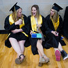 "From left to right, Hannah Hassel, Mikayla Lea and Morgan Gibson share a laugh while waiting for the commencement ceremony to begin for Monarch High School at 1stBank Center in Broomfield on Friday.<br /> More photos:  <a href=""http://www.dailycamera.com"">http://www.dailycamera.com</a><br /> Autumn Parry/Staff Photographer<br /> May 20, 2016"