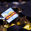 "A decorated cap reads ""to infinity and beyond"" among the class of 2016 graduates from Monarch High School during their commencement ceremony at 1stBank Center in Broomfield on Friday.<br /> More photos:  <a href=""http://www.dailycamera.com"">http://www.dailycamera.com</a><br /> Autumn Parry/Staff Photographer<br /> May 20, 2016"