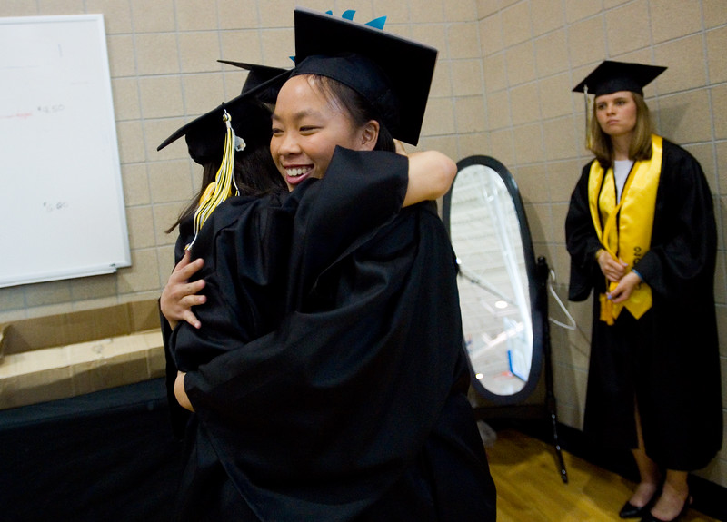 "Monica Mah hugs Hye Min Kim prior to the commencement ceremony for Monarch High School at 1stBank Center in Broomfield on Friday.<br /> More photos:  <a href=""http://www.dailycamera.com"">http://www.dailycamera.com</a><br /> Autumn Parry/Staff Photographer<br /> May 20, 2016"