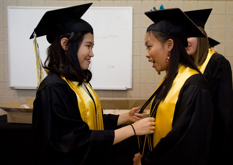 "Hye Min Kim and Monica Mah prepare for graduation prior to the commencement ceremony for Monarch High School at 1stBank Center in Broomfield on Friday.<br /> More photos:  <a href=""http://www.dailycamera.com"">http://www.dailycamera.com</a><br /> Autumn Parry/Staff Photographer<br /> May 20, 2016"