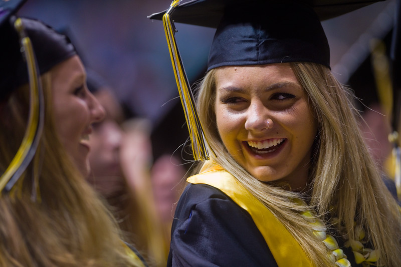 "Allie Battreall shares a laugh with a fellow graduate during the commencement ceremony for Monarch High School at 1stBank Center in Broomfield on Friday.<br /> More photos:  <a href=""http://www.dailycamera.com"">http://www.dailycamera.com</a><br /> Autumn Parry/Staff Photographer<br /> May 20, 2016"