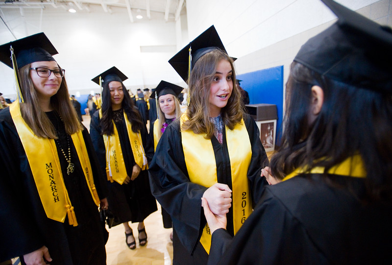 "Gabriela Emerson holds hands with Hye Min Kim prior to the commencement ceremony for Monarch High School at 1stBank Center in Broomfield on Friday.<br /> More photos:  <a href=""http://www.dailycamera.com"">http://www.dailycamera.com</a><br /> Autumn Parry/Staff Photographer<br /> May 20, 2016"