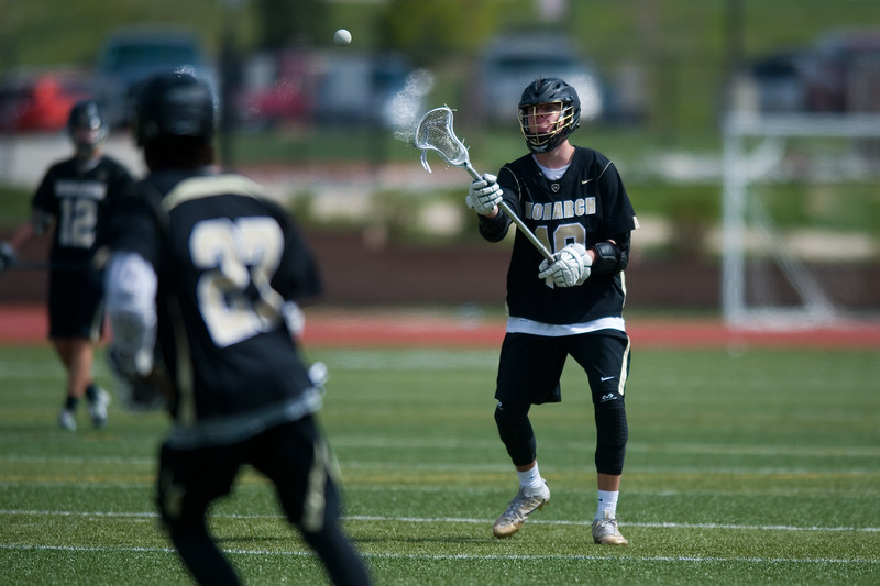 "Monarch High School's Andrew Zwiers passes the ball to a teammate during the 5A lacrosse quarterfinals against Mountain Vista at Legacy Stadium in Aurora on Saturday. Mountain Vista defeated Monarch 15-9.<br /> More photos:  <a href=""http://www.BoCoPreps.com"">http://www.BoCoPreps.com</a><br /> Autumn Parry/Staff Photographer<br /> May 14, 2016"