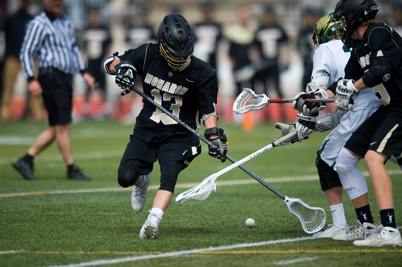 "Monarch High School's Danny Kowalski goes after a loose ball during the 5A lacrosse quarterfinals against Mountain Vista at Legacy Stadium in Aurora on Saturday. Mountain Vista defeated Monarch 15-9.<br /> More photos:  <a href=""http://www.BoCoPreps.com"">http://www.BoCoPreps.com</a><br /> Autumn Parry/Staff Photographer<br /> May 14, 2016"