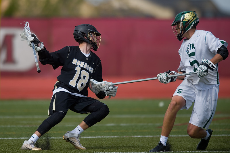 "Monarch High School's Andrew Zwier goes around Mountain Vista's Judd Erickson during the 5A lacrosse quarterfinals against Mountain Vista at Legacy Stadium in Aurora on Saturday. Mountain Vista defeated Monarch 15-9.<br /> More photos:  <a href=""http://www.BoCoPreps.com"">http://www.BoCoPreps.com</a><br /> Autumn Parry/Staff Photographer<br /> May 14, 2016"