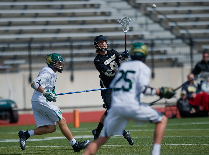 "Monarch High School's Chad Kreuzer passes the ball to a teammate during the 5A lacrosse quarterfinals against Mountain Vista at Legacy Stadium in Aurora on Saturday. Mountain Vista defeated Monarch 15-9.<br /> More photos:  <a href=""http://www.BoCoPreps.com"">http://www.BoCoPreps.com</a><br /> Autumn Parry/Staff Photographer<br /> May 14, 2016"