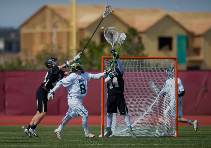 "Monarch's goalie Andrew Winans fends off a goal by Mountain Vista's Jake Harvey during the 5A lacrosse quarterfinals against Mountain Vista at Legacy Stadium in Aurora on Saturday. Mountain Vista defeated Monarch 15-9.<br /> More photos:  <a href=""http://www.BoCoPreps.com"">http://www.BoCoPreps.com</a><br /> Autumn Parry/Staff Photographer<br /> May 14, 2016"