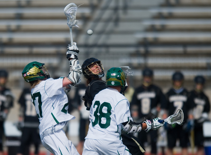 "Monarch's Chard Kreuzer tries to catch a loose ball  during the 5A lacrosse quarterfinals against Mountain Vista at Legacy Stadium in Aurora on Saturday. Mountain Vista defeated Monarch 15-9.<br /> More photos:  <a href=""http://www.BoCoPreps.com"">http://www.BoCoPreps.com</a><br /> Autumn Parry/Staff Photographer<br /> May 14, 2016"