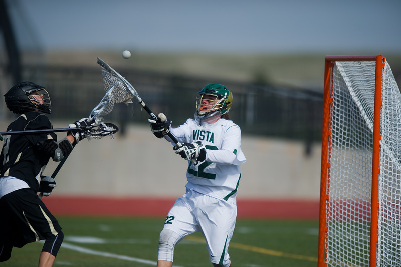 "Mountain Vista's Paxton Boyer blocks a goal by Monarch's Brock Tausan  during the 5A lacrosse quarterfinals against Mountain Vista at Legacy Stadium in Aurora on Saturday. Mountain Vista defeated Monarch 15-9.<br /> More photos:  <a href=""http://www.BoCoPreps.com"">http://www.BoCoPreps.com</a><br /> Autumn Parry/Staff Photographer<br /> May 14, 2016"