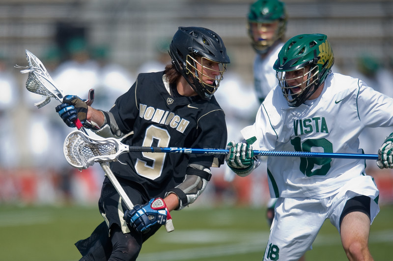 "Monarch's Chad Kreuzer goes around Mountain Vista's Noah Hirshorn during the 5A lacrosse quarterfinals against Mountain Vista at Legacy Stadium in Aurora on Saturday. Mountain Vista defeated Monarch 15-9.<br /> More photos:  <a href=""http://www.BoCoPreps.com"">http://www.BoCoPreps.com</a><br /> Autumn Parry/Staff Photographer<br /> May 14, 2016"