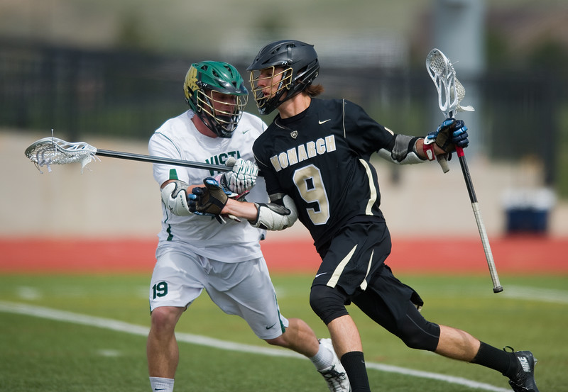 "Monarch High School's Chad Kreuzer fends off Mountain Vista's defense as he heads toward the goal during the 5A lacrosse quarterfinals against Mountain Vista at Legacy Stadium in Aurora on Saturday. Mountain Vista defeated Monarch 15-9.<br /> More photos:  <a href=""http://www.BoCoPreps.com"">http://www.BoCoPreps.com</a><br /> Autumn Parry/Staff Photographer<br /> May 14, 2016"