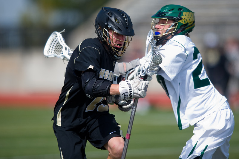 "Mountain Vista's Jack McFarlane shoves Monarch's Andrew Zwiers  as Zwiers heads down the field during the 5A lacrosse quarterfinals against Mountain Vista at Legacy Stadium in Aurora on Saturday. Mountain Vista defeated Monarch 15-9.<br /> More photos:  <a href=""http://www.BoCoPreps.com"">http://www.BoCoPreps.com</a><br /> Autumn Parry/Staff Photographer<br /> May 14, 2016"
