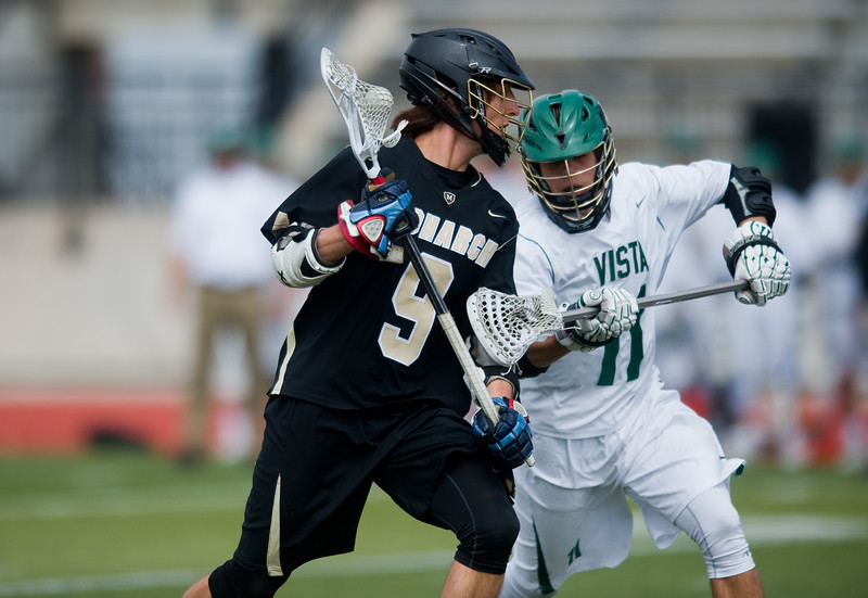 "Mountain Vista's Brad Oren defends against Monarch's Chad Kreuzer as he heads down the field during the 5A lacrosse quarterfinals against Mountain Vista at Legacy Stadium in Aurora on Saturday. Mountain Vista defeated Monarch 15-9.<br /> More photos:  <a href=""http://www.BoCoPreps.com"">http://www.BoCoPreps.com</a><br /> Autumn Parry/Staff Photographer<br /> May 14, 2016"