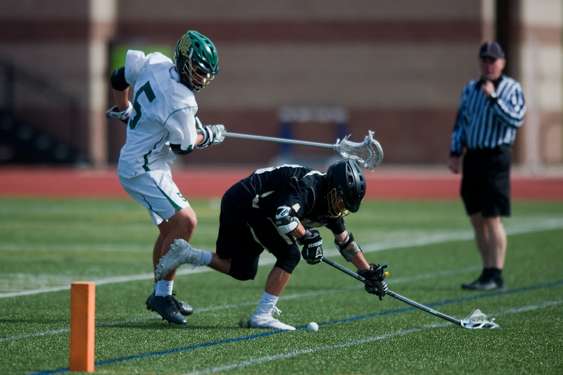 "Mountain Vista's Judd Erickson and Monarch High School's Danny Kowalski chase after a loose ball during the 5A lacrosse quarterfinals against Mountain Vista at Legacy Stadium in Aurora on Saturday. Mountain Vista defeated Monarch 15-9.<br /> More photos:  <a href=""http://www.BoCoPreps.com"">http://www.BoCoPreps.com</a><br /> Autumn Parry/Staff Photographer<br /> May 14, 2016"