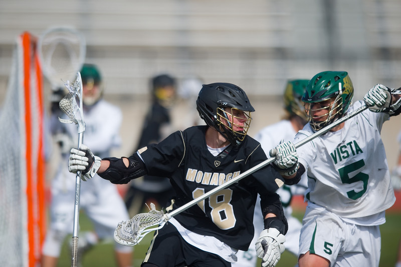 "Monarch's Andrew Zwiers tries to go around Mountain Vista's Judd Erickson as he attempts to score during the 5A lacrosse quarterfinals against Mountain Vista at Legacy Stadium in Aurora on Saturday. Mountain Vista defeated Monarch 15-9.<br /> More photos:  <a href=""http://www.BoCoPreps.com"">http://www.BoCoPreps.com</a><br /> Autumn Parry/Staff Photographer<br /> May 14, 2016"