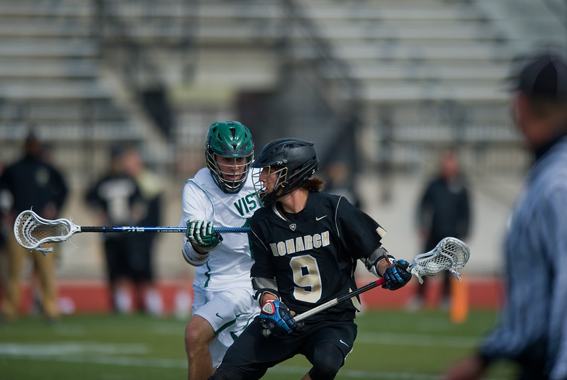 "Monarch's Chad Kreuzer goes around Mountain Vista's defense  during the 5A lacrosse quarterfinals against Mountain Vista at Legacy Stadium in Aurora on Saturday. Mountain Vista defeated Monarch 15-9.<br /> More photos:  <a href=""http://www.BoCoPreps.com"">http://www.BoCoPreps.com</a><br /> Autumn Parry/Staff Photographer<br /> May 14, 2016"