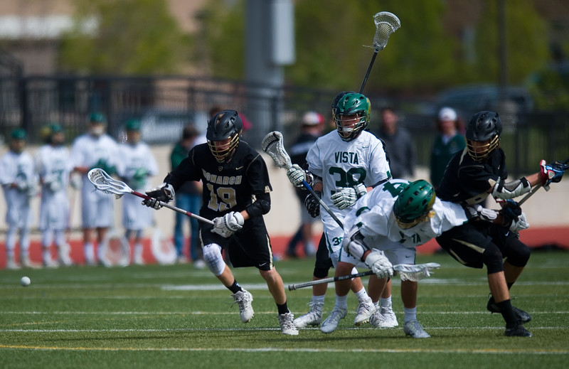 "Monarch High School's Dylan Haines (left) goes after a loose ball during the 5A lacrosse quarterfinals against Mountain Vista at Legacy Stadium in Aurora on Saturday. Mountain Vista defeated Monarch 15-9.<br /> More photos:  <a href=""http://www.BoCoPreps.com"">http://www.BoCoPreps.com</a><br /> Autumn Parry/Staff Photographer<br /> May 14, 2016"