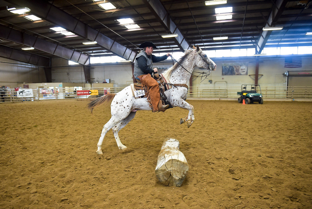 . Lee Bennett, of Grand Island, Neb., rides Chockafellar over a log during the junior ranch trail competition at the Mountain & Plains Appaloosa Horse Club\'s Spring Classic Horse Show Sunday at the Boulder County Fairgrounds. The event, which started Friday, had more than 50 horses entered. Competitors traveled from Nebraska, New Mexico, Arizona as well as western Colorado and the Longmont area. The Mountain & Plains Appaloosa Horse Club will be hosting another show at the fairgrounds in September. To view more photos visit timescall.com. Lewis Geyer/Staff Photographer May 13, 2018