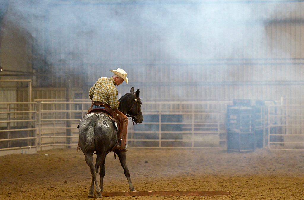 . With artificial smoke hovering overhead, Julian Memmers, of Longmont, rides Charlie in the junior ranch trail event during the Mountain & Plains Appaloosa Horse Club\'s Spring Classic Horse Show Sunday at the Boulder County Fairgrounds. The event, which started Friday, had more than 50 horses entered. Competitors traveled from Nebraska, New Mexico, Arizona as well as western Colorado and the Longmont area. The Mountain & Plains Appaloosa Horse Club will be hosting another show at the fairgrounds in September. To view more photos visit timescall.com. Lewis Geyer/Staff Photographer May 13, 2018