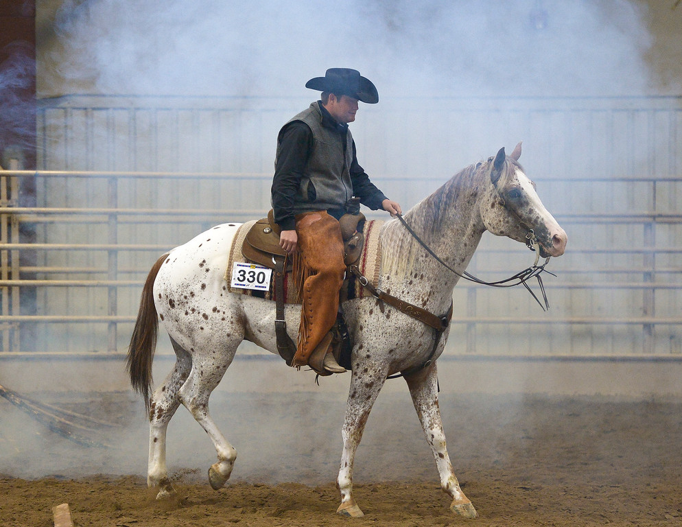 . Lee Bennett, of Grand Island, Nebraska, rides Chockafellar through artificial smoke during the junior ranch trail competition at the Mountain & Plains Appaloosa Horse Club\'s Spring Classic Horse Show Sunday at the Boulder County Fairgrounds. The event, which started Friday, had more than 50 horses entered. Competitors traveled from Nebraska, New Mexico, Arizona as well as western Colorado and the Longmont area. The Mountain & Plains Appaloosa Horse Club will be hosting another show at the fairgrounds in September. To view more photos visit timescall.com. Lewis Geyer/Staff Photographer May 13, 2018