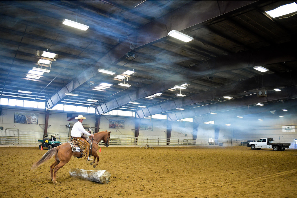 . With artificial smoke hovering overhead, Cody Crow, of Johnstown, rides Sally in the junior ranch trail event during the Mountain & Plains Appaloosa Horse Club\'s Spring Classic Horse Show Sunday at the Boulder County Fairgrounds. The event, which started Friday, had more than 50 horses entered. Competitors traveled from Nebraska, New Mexico, Arizona as well as western Colorado and the Longmont area. The Mountain & Plains Appaloosa Horse Club will be hosting another show at the fairgrounds in September. To view more photos visit timescall.com. Lewis Geyer/Staff Photographer May 13, 2018