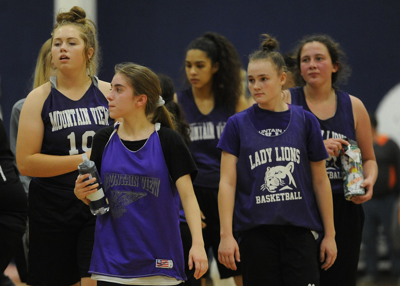 Members of the Mountain View girls basketball team walk off the floor after a scrimmage at Power to Play Sports.