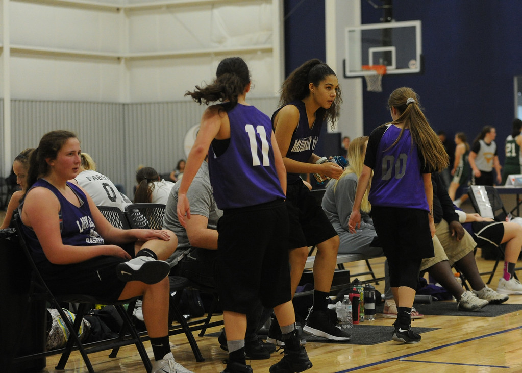 . Mountain View girls basketball players watch their team\'s scrimmage at Power to Play Sports.