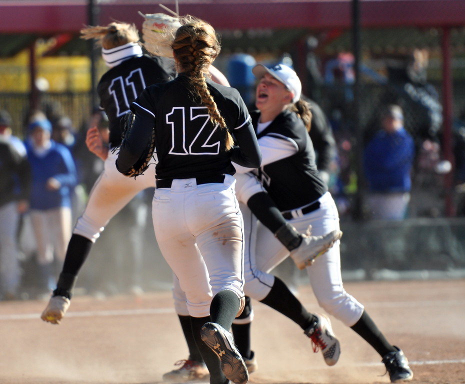 Mountain View's Madison Langman (12) runs to the circle to join her teammates celebrating winning the state championship Saturday in Aurora. (Cris Tiller / Loveland Reporter-Herald)