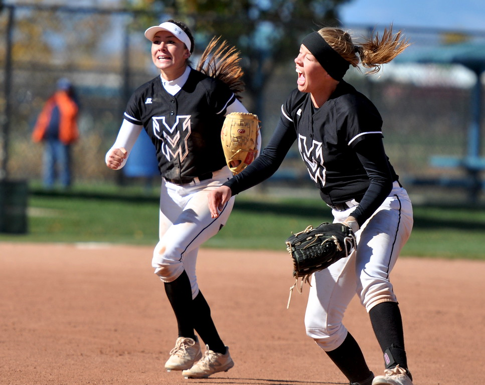 Mountain View's Peyton Duke, right, celebrates the final out of the state semifinal against Mullen on Saturday in Aurora. (Cris Tiller / Loveland Reporter-Herald)