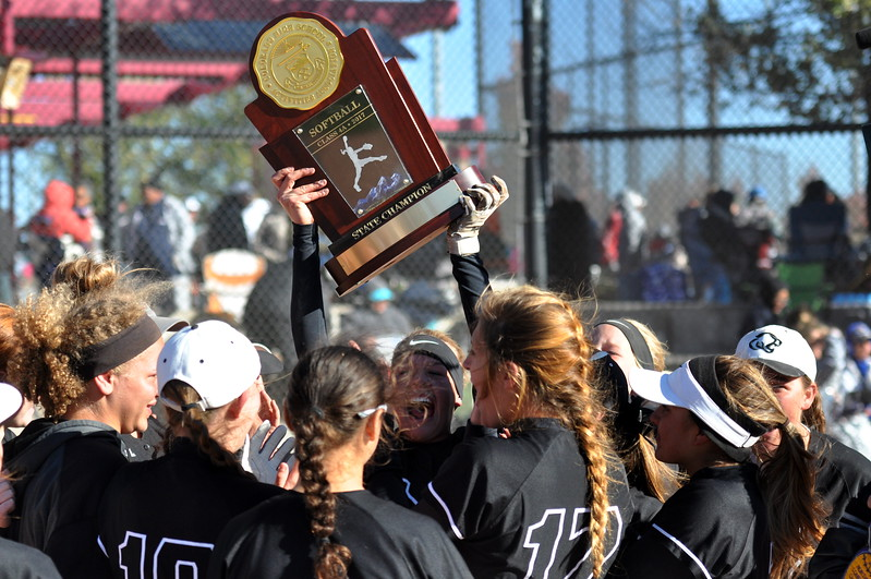 Mountain View hoistes the championship trophy after winning its first state title Saturday in Aurora. (Cris Tiller / Loveland Reporter-Herald)