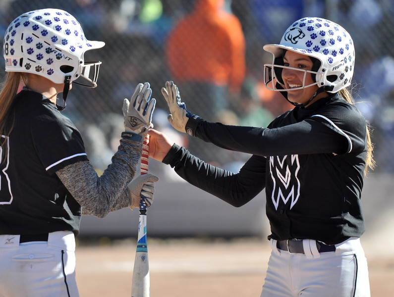 Mountain View's Jaelyn Taylor, right, high fives teammate Jaycee Schroeder on Saturday in the state championships. (Cris Tiller / Loveland Reporter-Herald)