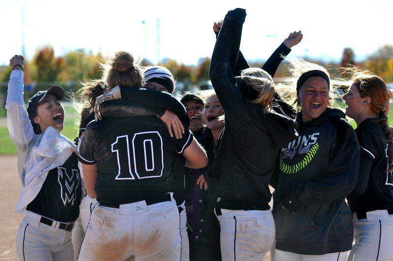 Mountain View pitcher Bailey Carlson (10) is hugged by teammate Peyton Duke after winning the state championship Saturday in Aurora. (Cris Tiller / Loveland Reporter-Herald)