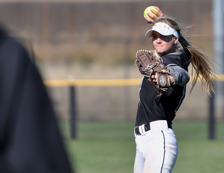 Mountain View outfielder Jaycee Schroeder warms up between innings Saturday in Aurora at the state championships. (Cris Tiller / Loveland Reporter-Herald)
