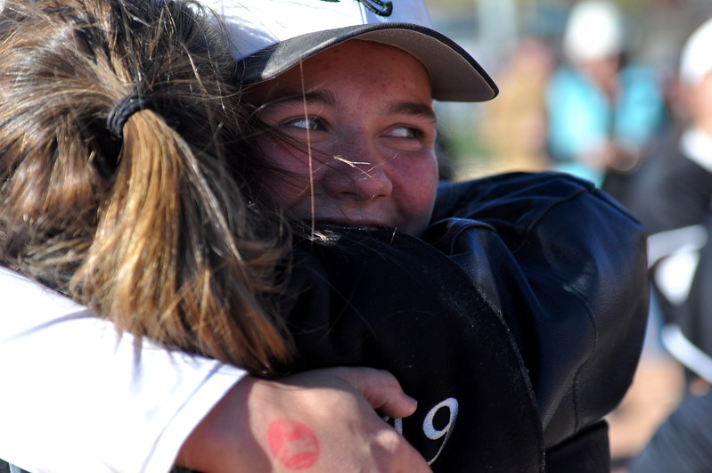 Mountain View's RaLeigh Basart hugs a teammate after winning the state championship Saturday in Aurora. (Cris Tiller / Loveland Reporter-Herald)
