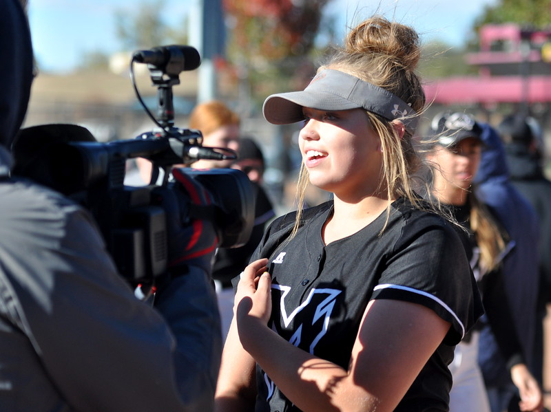 Mountain View freshman pitcher Bailey Carlson does a interview after winning the state championship Saturday in Aurora. (Cris Tiller / Loveland Reporter-Herald)