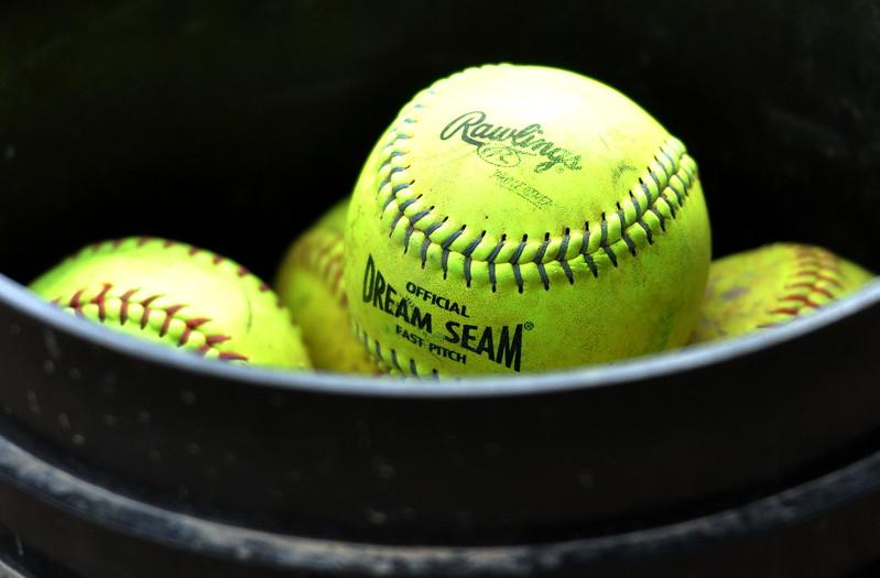 Generic shot of a bucket of softballs. (Cris Tiller / Loveland Reporter-Herald)