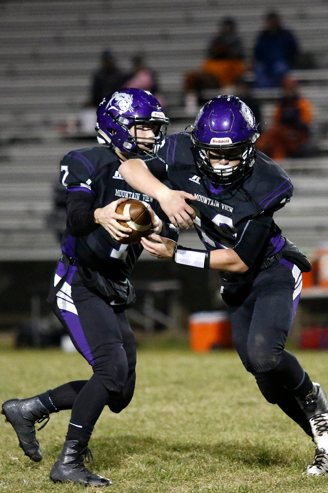 Mountain View's Peyton Mayes (7) fakes passing the ball to Chad Baumann (19) on Friday, Oct. 27, 2017, at Patterson Stadium in Loveland. (Photo by Lauren Cordova/Loveland Reporter-Herald)