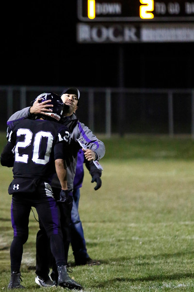 Mountain View's coach Bart Mayes hugs Erik Contreras (20) after he scores a touchdown on Friday, Oct. 27, 2017, at Patterson Stadium in Loveland. (Photo by Lauren Cordova/Loveland Reporter-Herald)