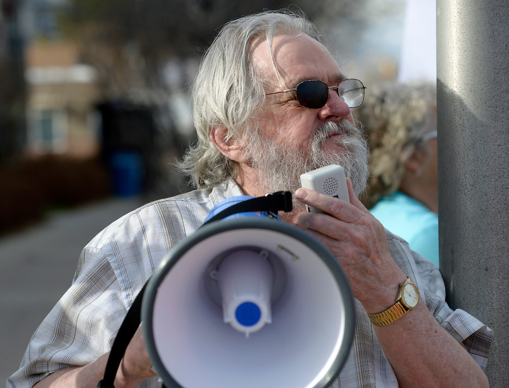 . LONGMONT, CO - APRIL 4: Bill Clinton uses a megaphone during the Day of Action protest Protest calling for Attorney General William Barr to release the Mueller report. The protest was along Main Street, at Sixth Avenue, April 4, 2019. To view more photos visit timescall.com. (Photo by Lewis Geyer/Staff Photographer)