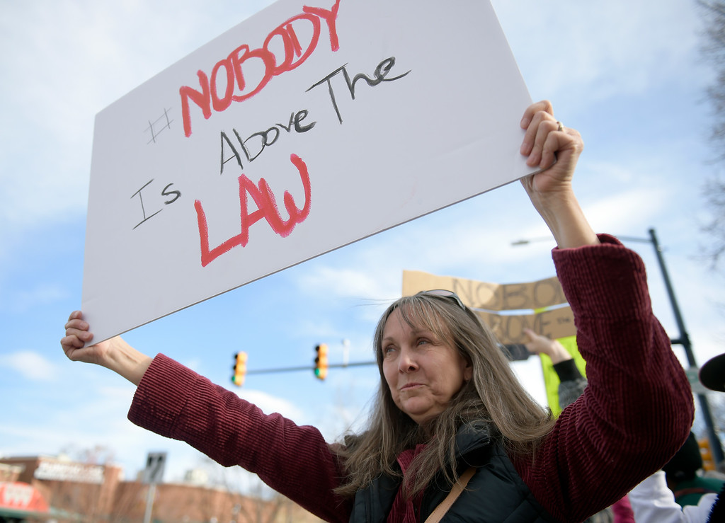 . LONGMONT, CO - APRIL 4: Kayann Short participates in the Day of Action protest Protest calling for Attorney General William Barr to release the Mueller report. The protest was along Main Street, at Sixth Avenue, April 4, 2019. To view more photos visit timescall.com. (Photo by Lewis Geyer/Staff Photographer)