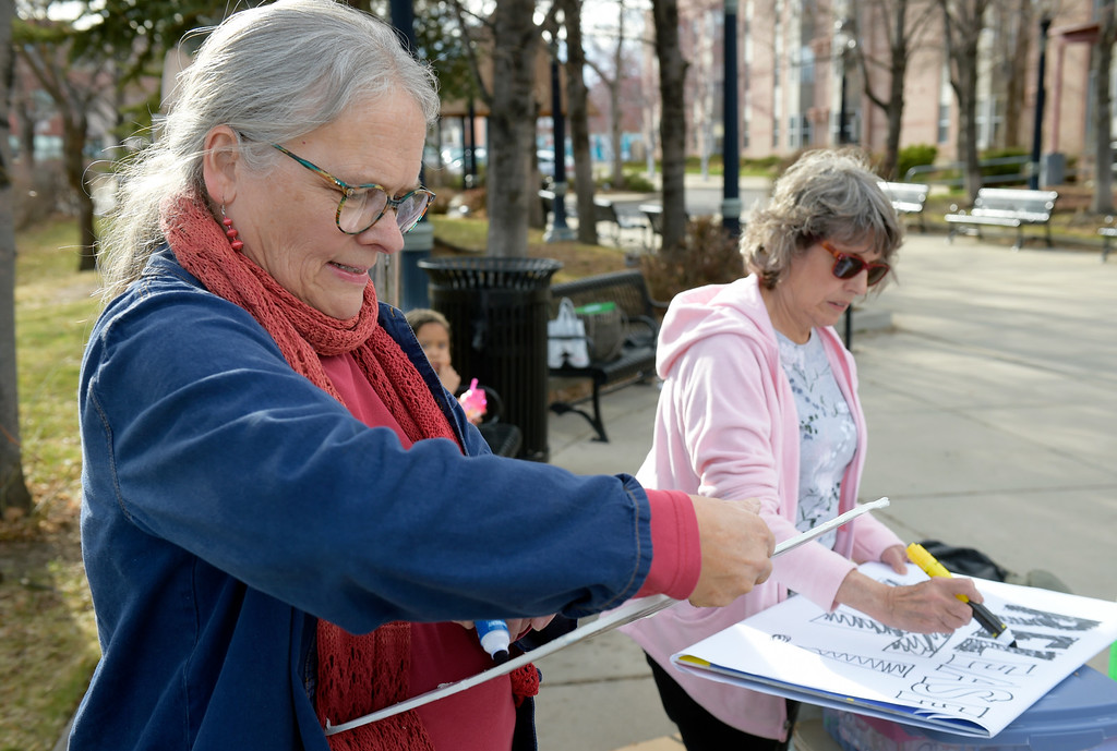 . LONGMONT, CO - APRIL 4: Kathy Partridge, left, and Lynette McClain make signs during the Day of Action protest Protest calling for Attorney General William Barr to release the Mueller report. The protest was along Main Street, at Sixth Avenue, April 4, 2019. To view more photos visit timescall.com. (Photo by Lewis Geyer/Staff Photographer)
