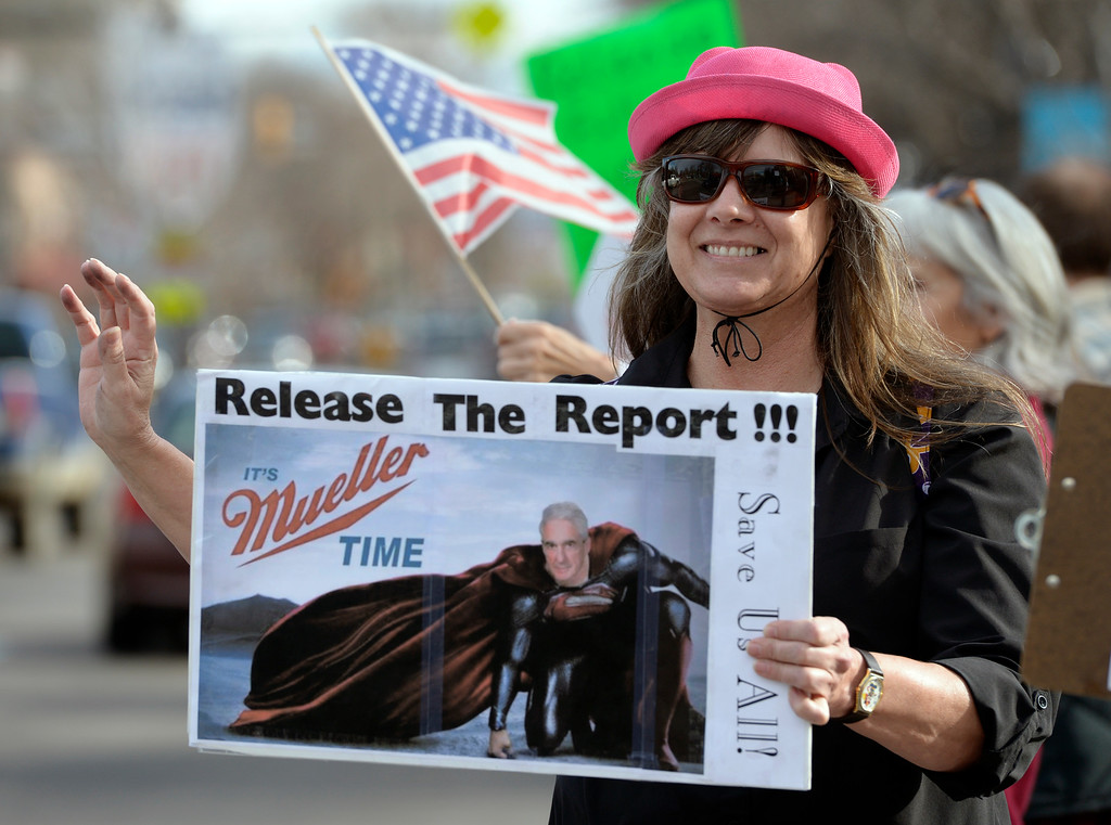 . LONGMONT, CO - APRIL 4: Jamie Seper waves to passing cars during the Day of Action protest Protest calling for Attorney General William Barr to release the Mueller report. The protest was along Main Street, at Sixth Avenue, April 4, 2019. To view more photos visit timescall.com. (Photo by Lewis Geyer/Staff Photographer)