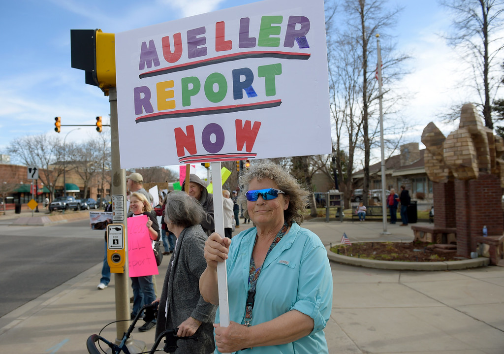 . LONGMONT, CO - APRIL 4: Marilyn Z. holds a sign during the Day of Action protest Protest calling for Attorney General William Barr to release the Mueller report. The protest was along Main Street, at Sixth Avenue, April 4, 2019. To view more photos visit timescall.com. (Photo by Lewis Geyer/Staff Photographer)